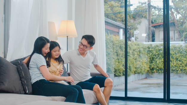 happy young asian family play together couch home chinese mother father child daughter enjoying happy relax spending time together modern living room evening 7861 2318